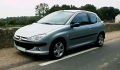 PEUGEOT 206 S16 concurrente l' OPEL Astra 2.0 Turbo Cosmo